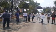 Bloquean Circuito en La Raza en demanda de cubrebocas, guantes...