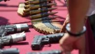 FGR asegura más de 5 mil cartuchos, armas largas y dinero en efectivo