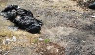 En Tultitlán, localizan cuerpo cercenado de una mujer en 5 bolsas