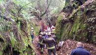 Derrumbe de barda sepulta a 2 hombres en Tlalpan y muere uno