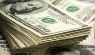 Venden hasta en 20.27 pesos el dólar en casas de cambio del AICM