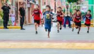 """FOTOS: Niño corre """"descalzo"""" y gana competencia atlética en Yucatán"""