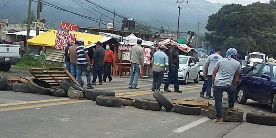 Por riña habitantes de Tlalpan cierran la carretera México-Cuernavaca