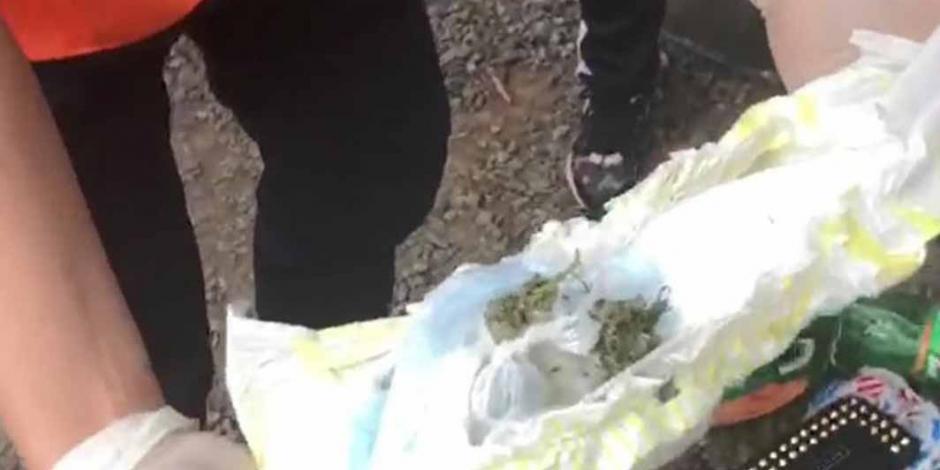 Mujer intenta meter marihuana al estadio dentro del pañal de su bebé