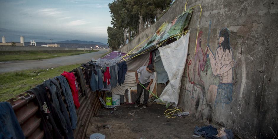 FOTOS: Así viven inmigrantes a un costado del muro fronterizo
