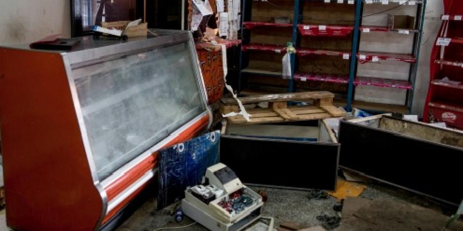 Saqueos masivos dejan negocios desolados en Venezuela