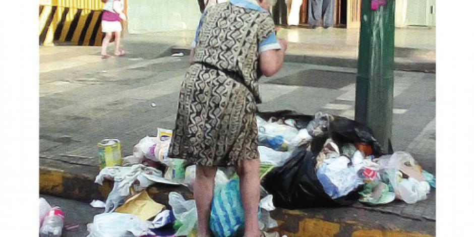 Aumenta clase media venezolana que come en tiraderos