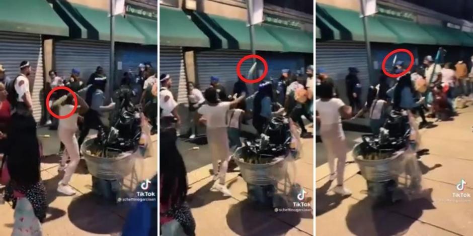 Mujer lanza elotazo a policía